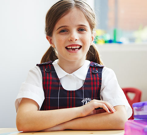 Young girl in Primrose School uniform.