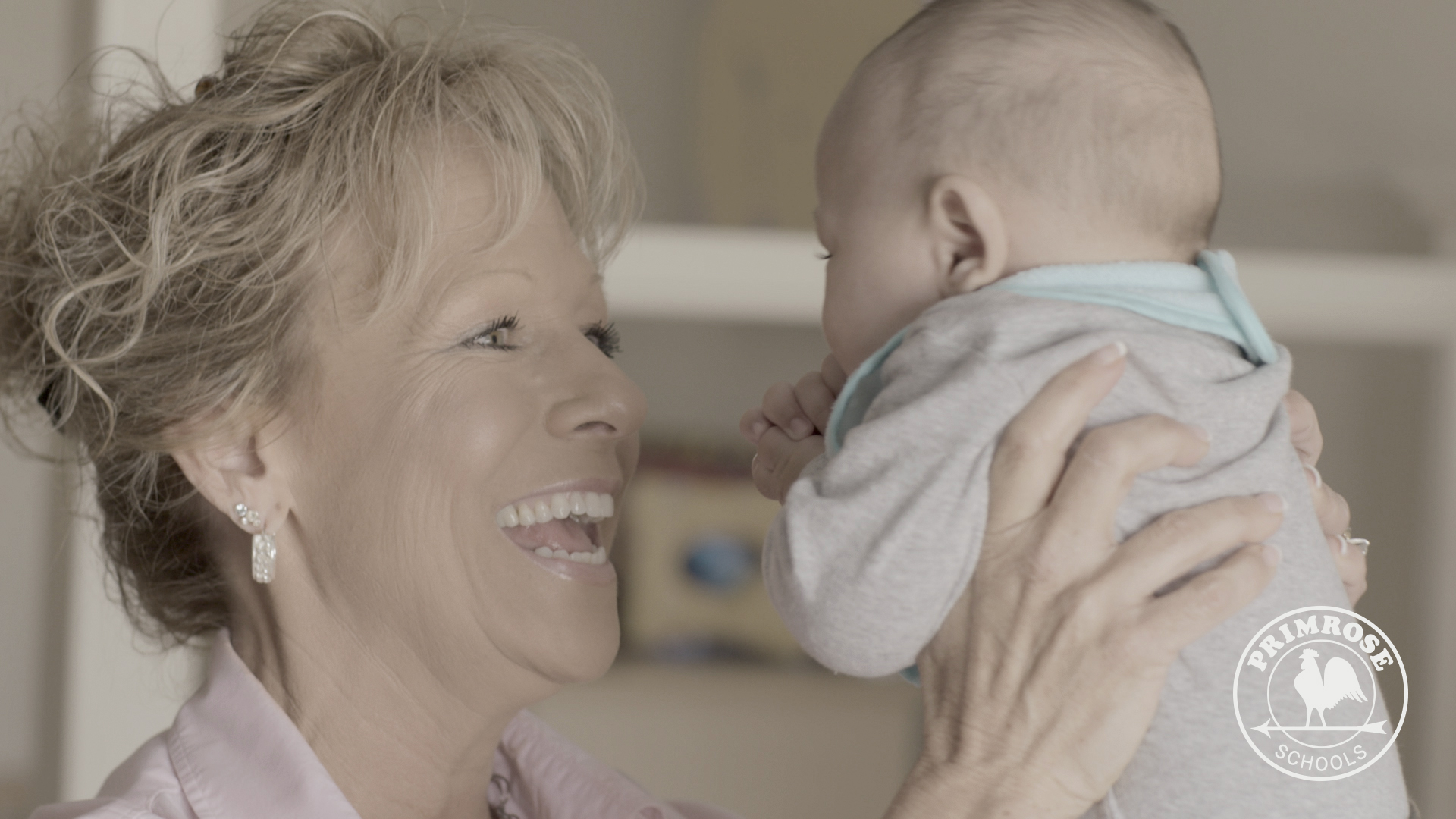 Primrose franchise owner of Dallas-area DeDee Gebhardt holding a small child